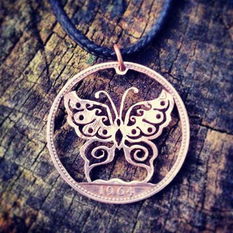 vlinder hanger gemaakt van munten